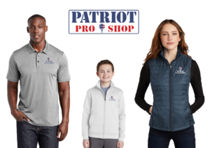 man, child, and woman, standing and wearing 'tee it up for the troops' themed polos and jacketss