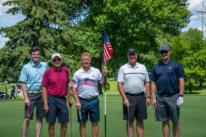Patrick with veteran support organization friends at a recent Tee It Up for the Troops event.